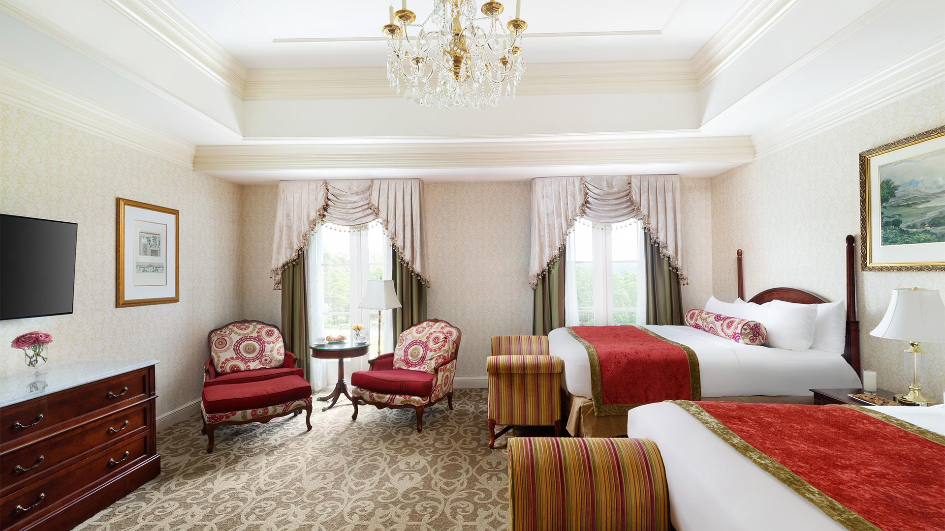 interior shot of The Chateau's Double accommodation. there are two queen beds, windows overlooking the resort grounds and a small sitting area.