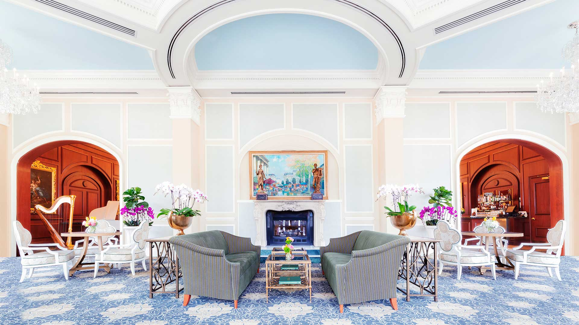large blue room with lots of seating and art