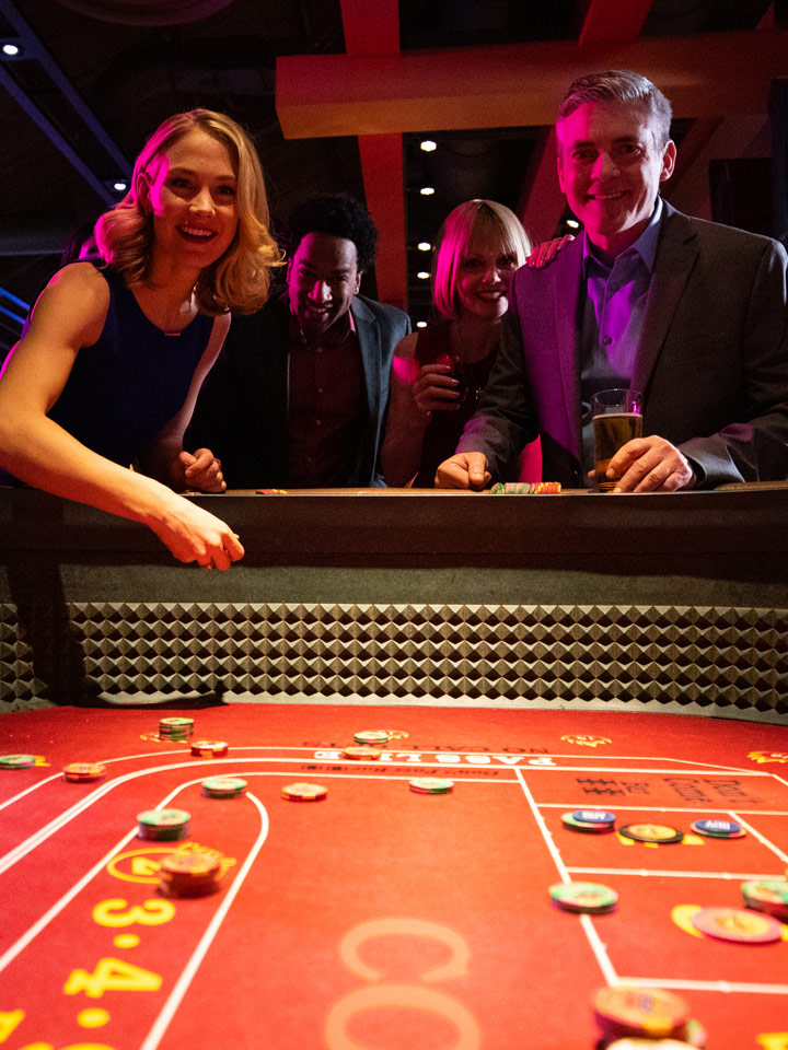 People enjoying a game at the casino