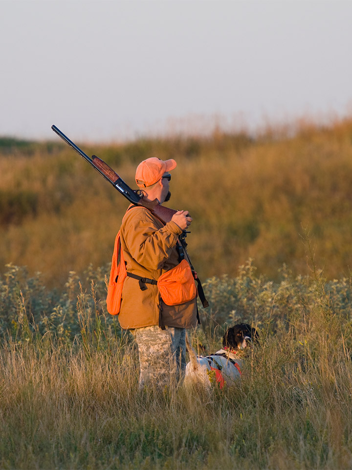 A man hunting with his dog.