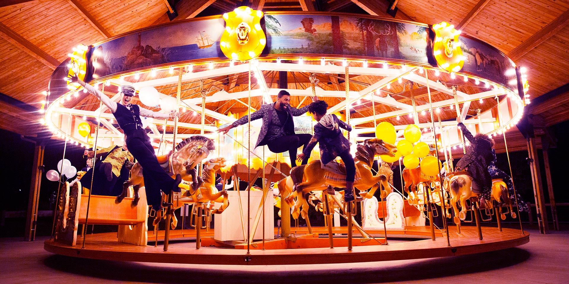 people enjoying a carousel