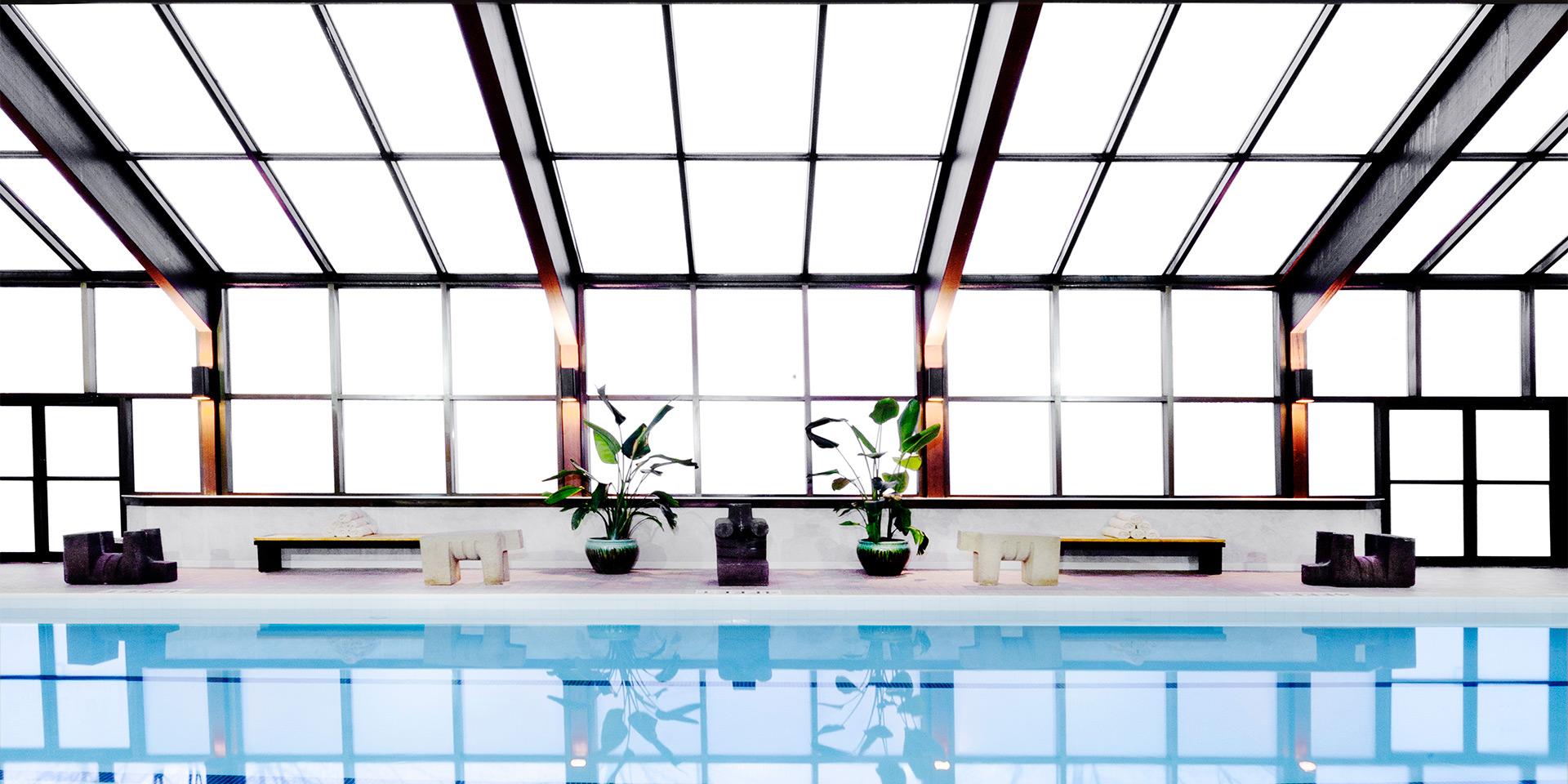 beautiful indoor pool with big windows
