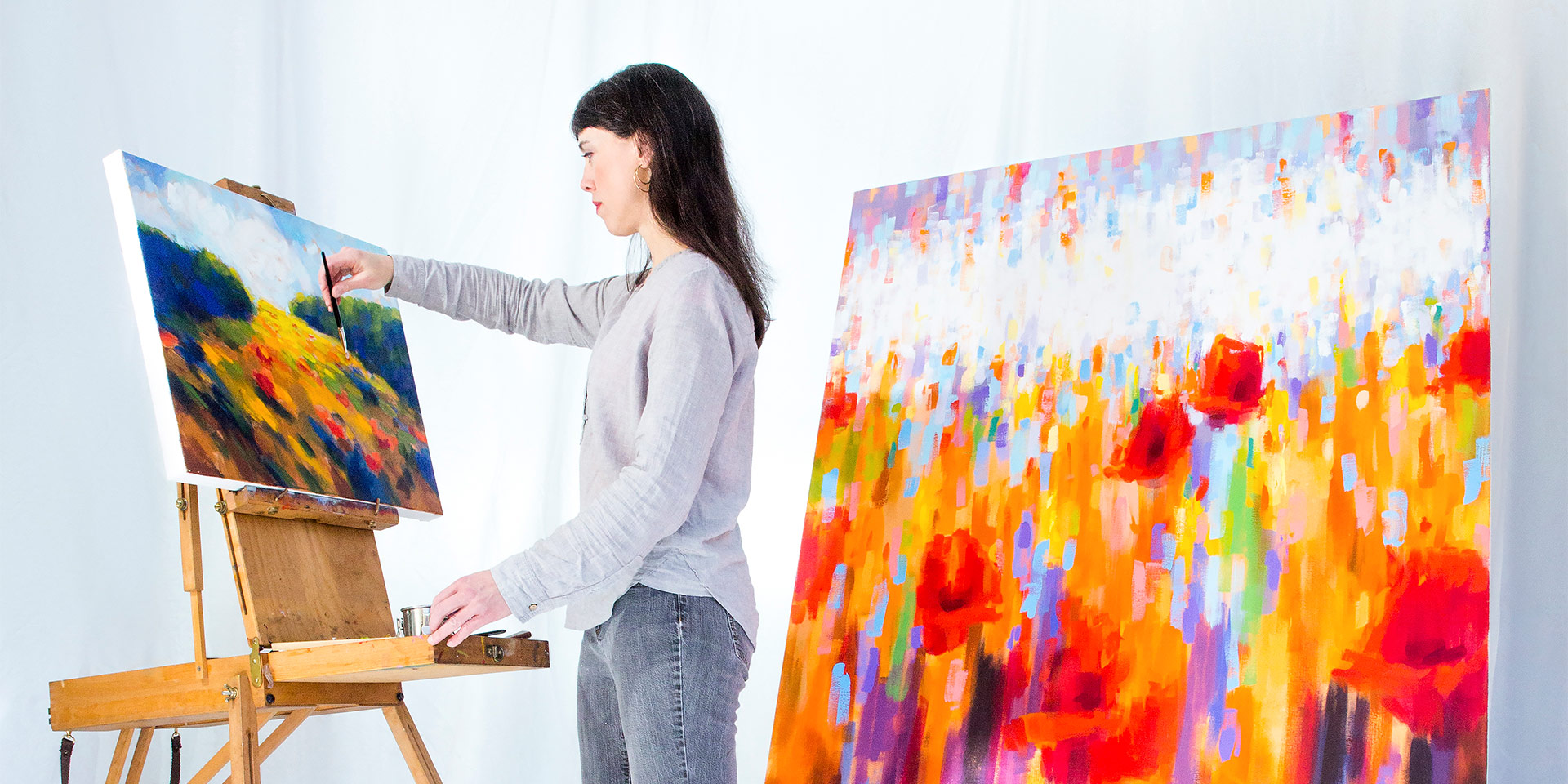 a girl working on two paintings