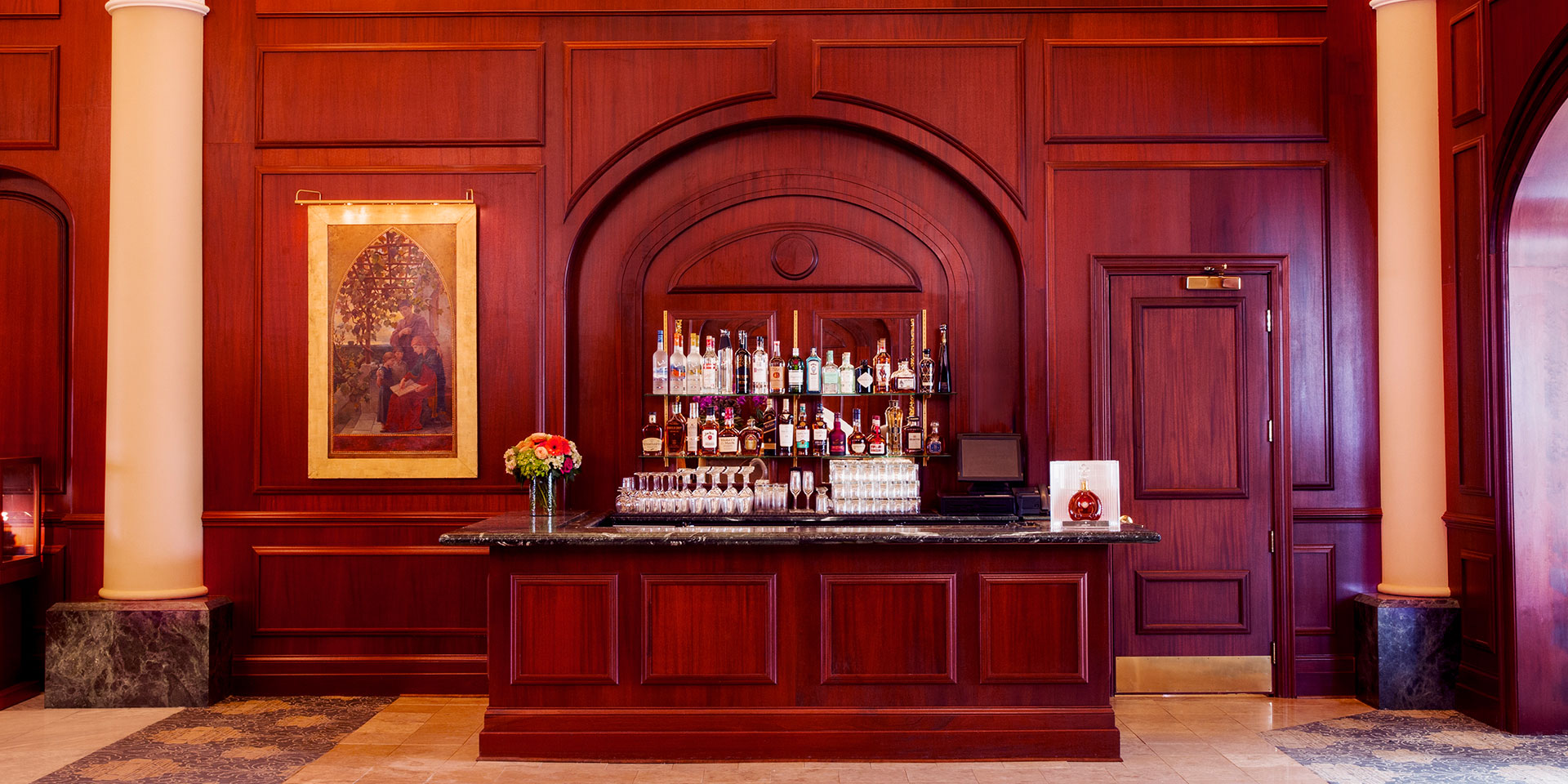 Fancy bar in front of wooden walls