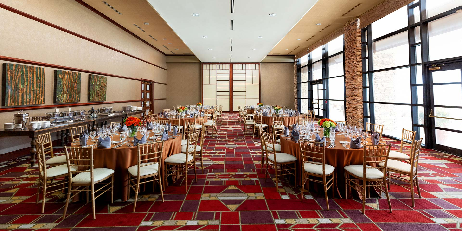 large dining room with red patterned carpet