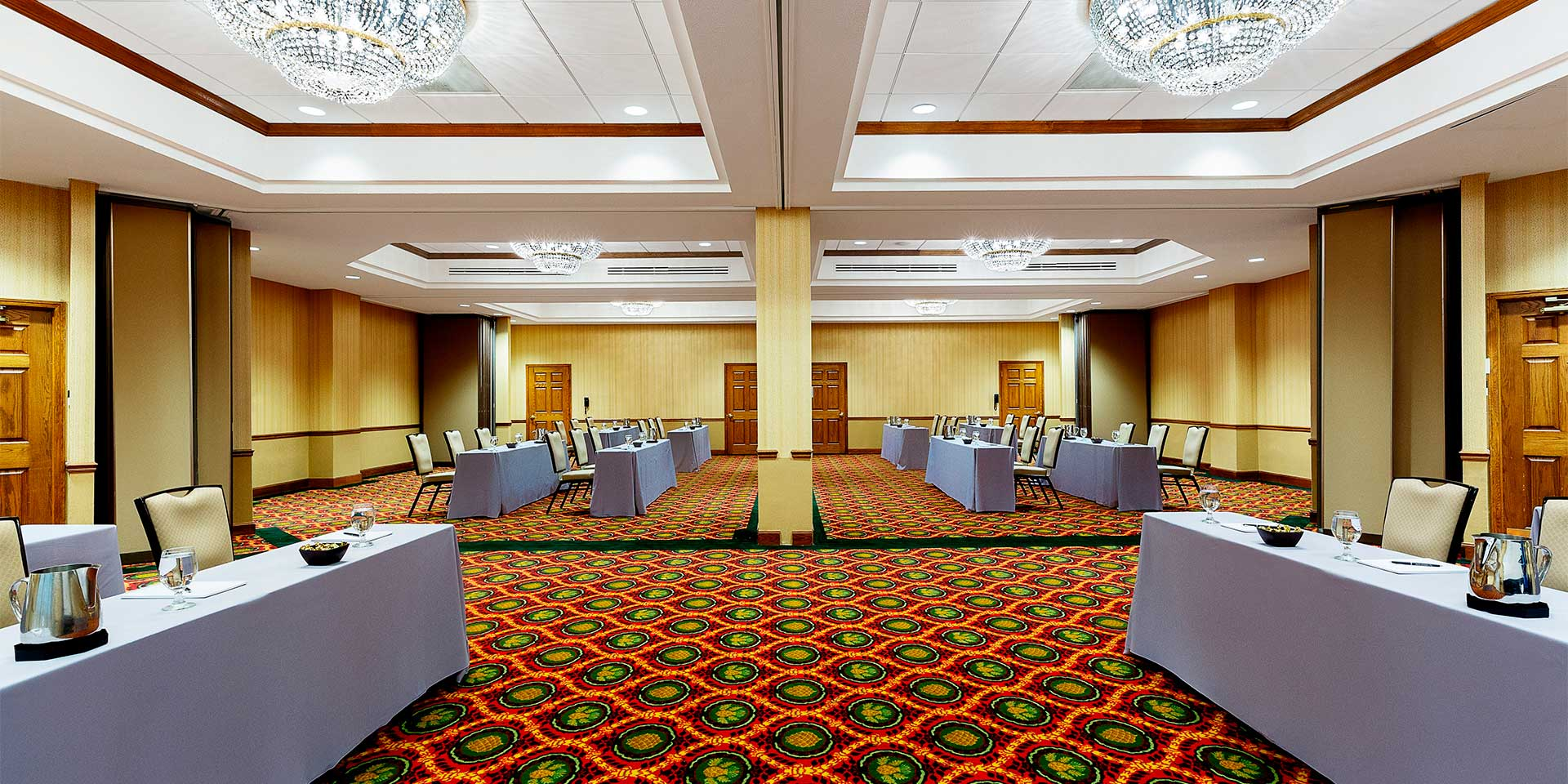large room with tables facing each other