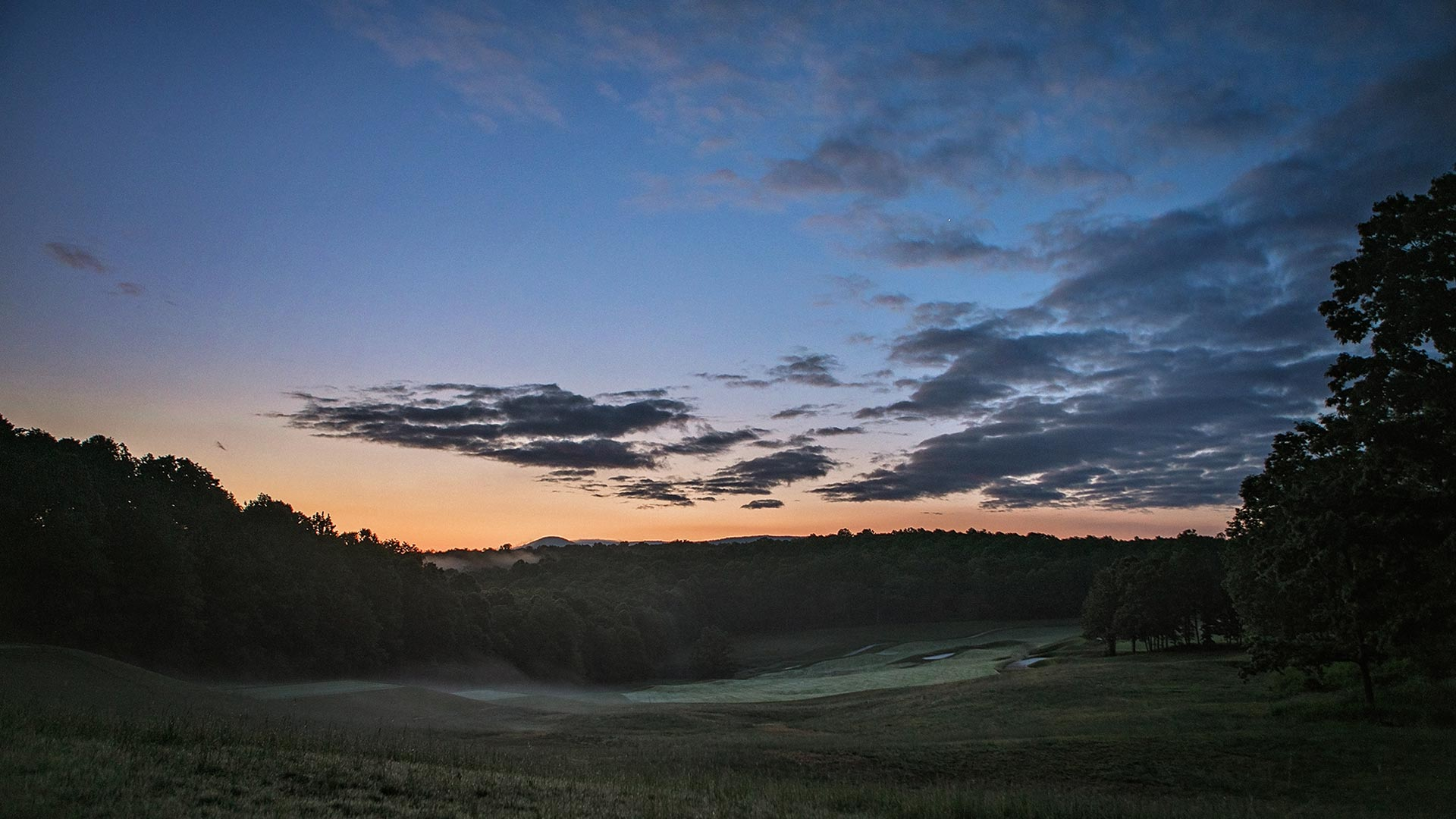 landscape view of golf course at dusk