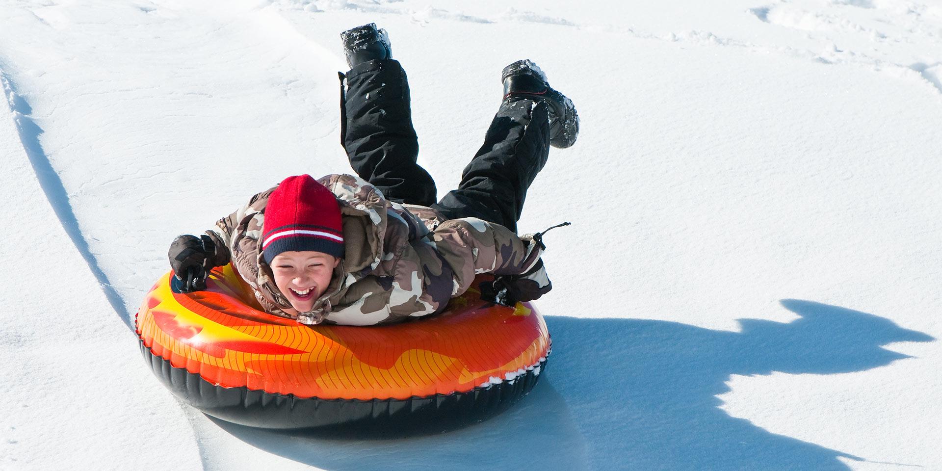 boy in snow tube