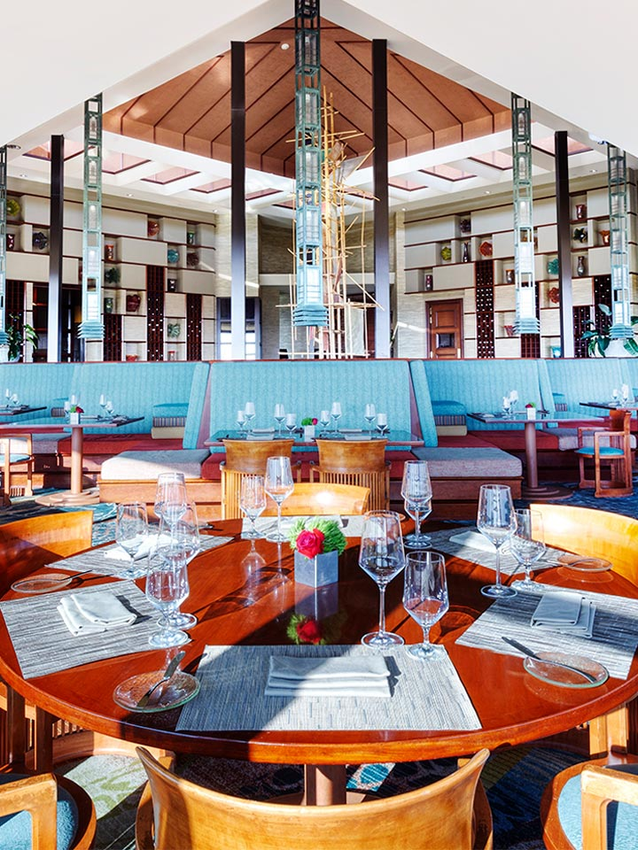 restaurant with blue booth seating and a modern open interior design