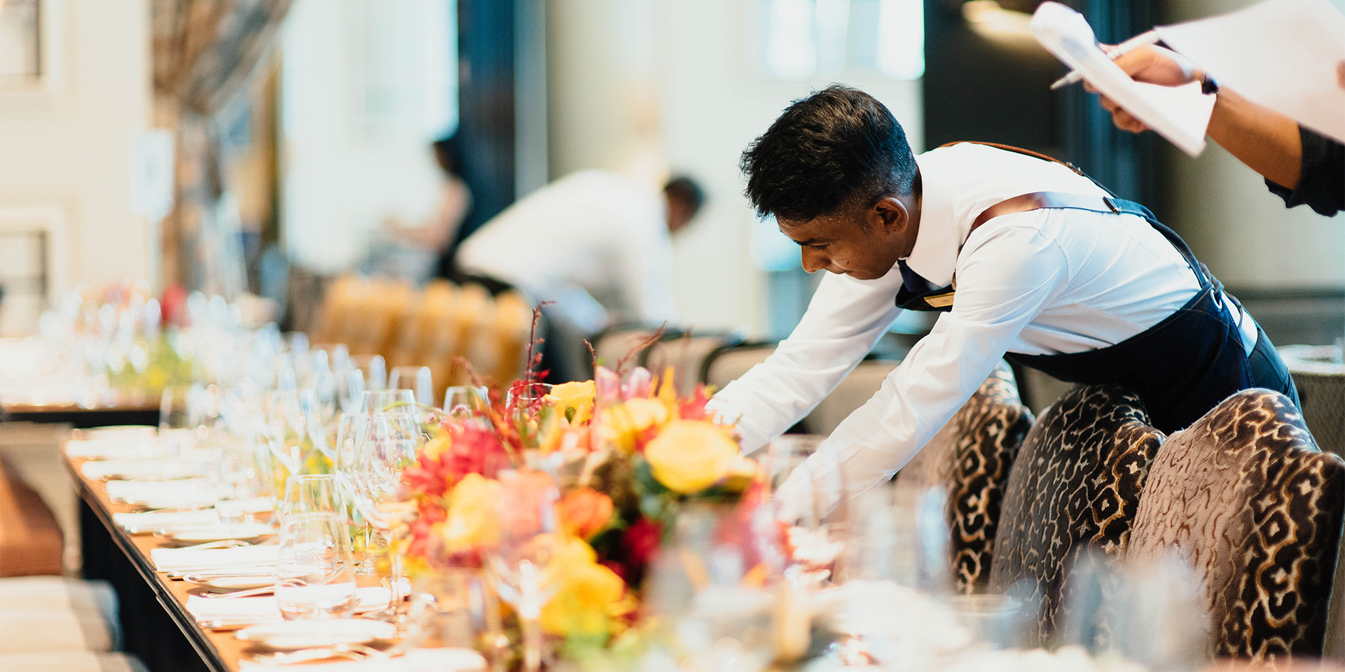 waiters setting a fancy table