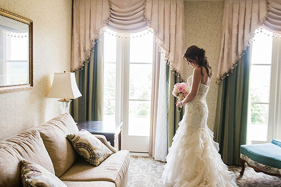 bride holding flowers in a hotel room