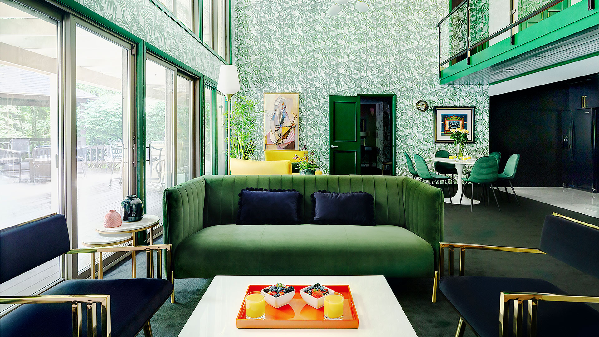 green room with green couch, green walls, and green door