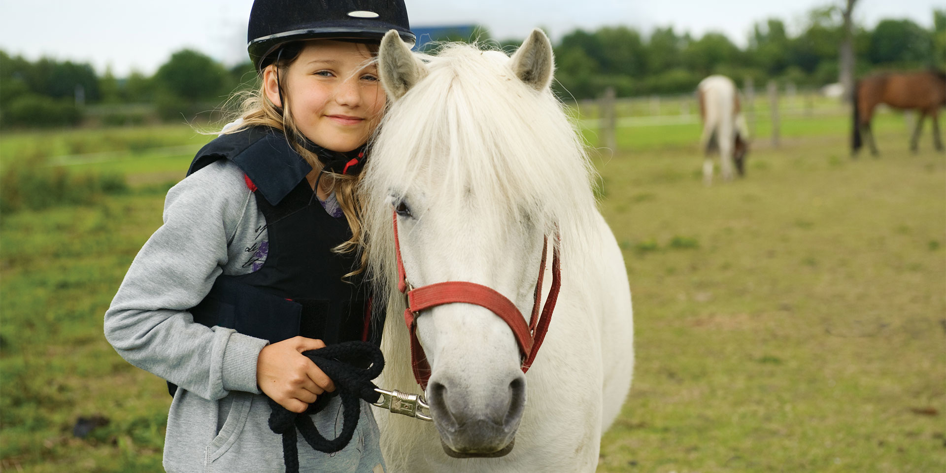 young girl with white pony