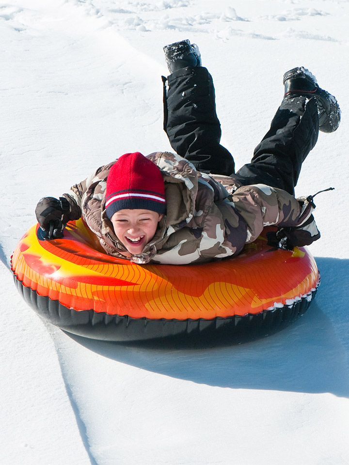 boy on snow tube