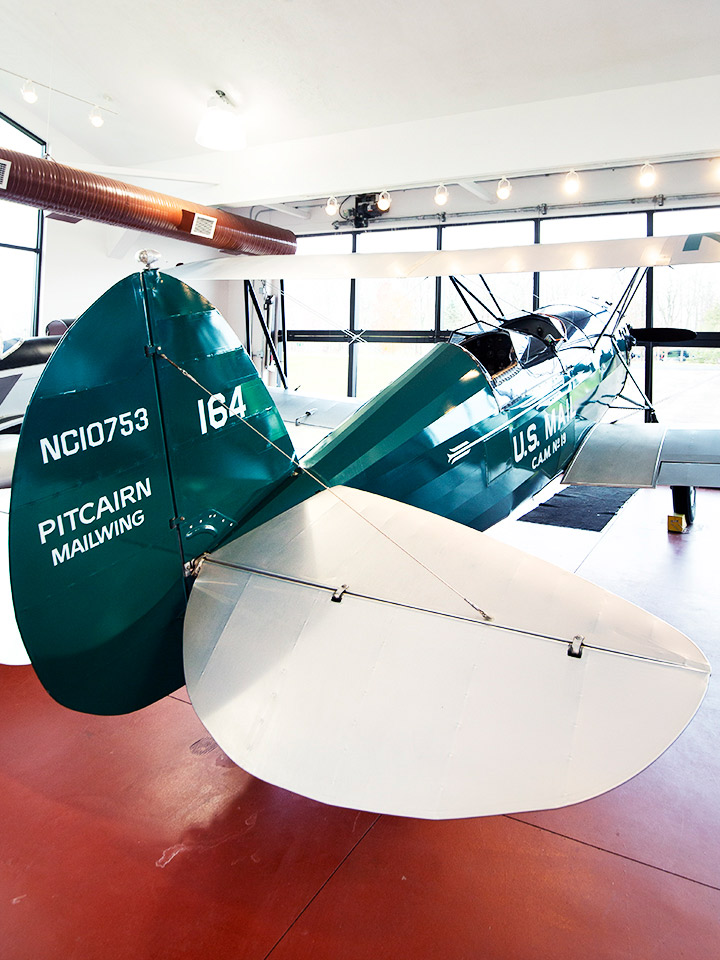 Indoor old fashioned green and white plane