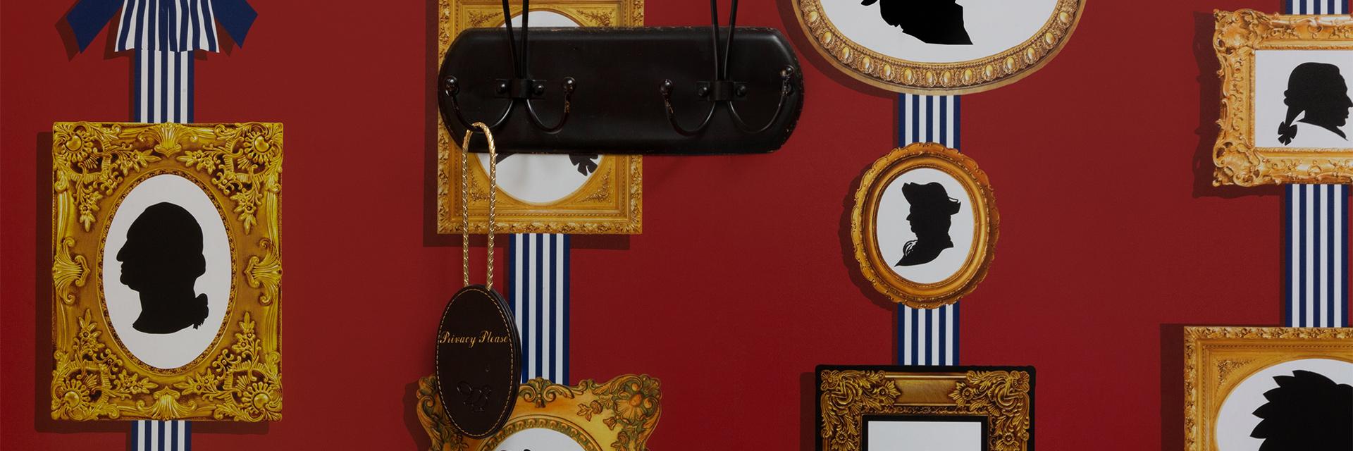 silhouettes of presidents inside golden frames