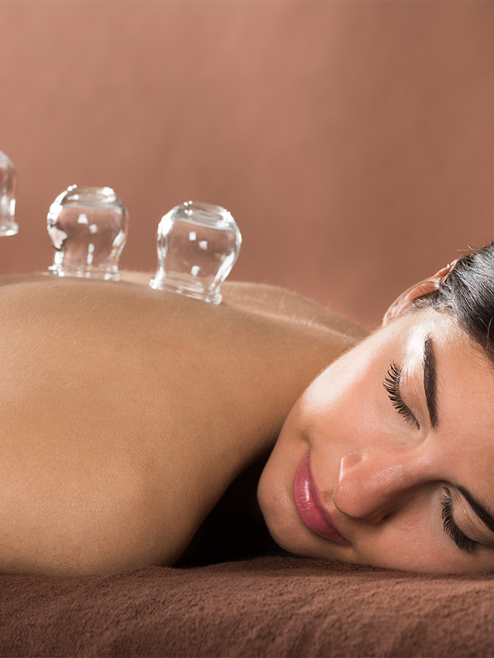 a woman enjoying a holistic integrative therapy treatment.