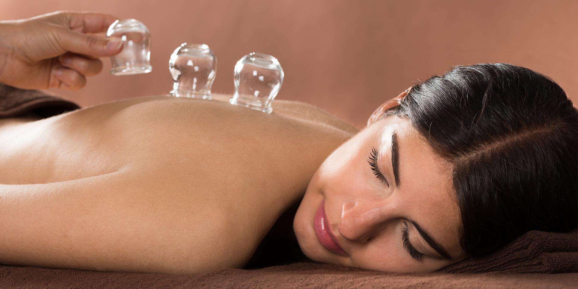 a woman enjoying a holistic integrative therapy treatment.