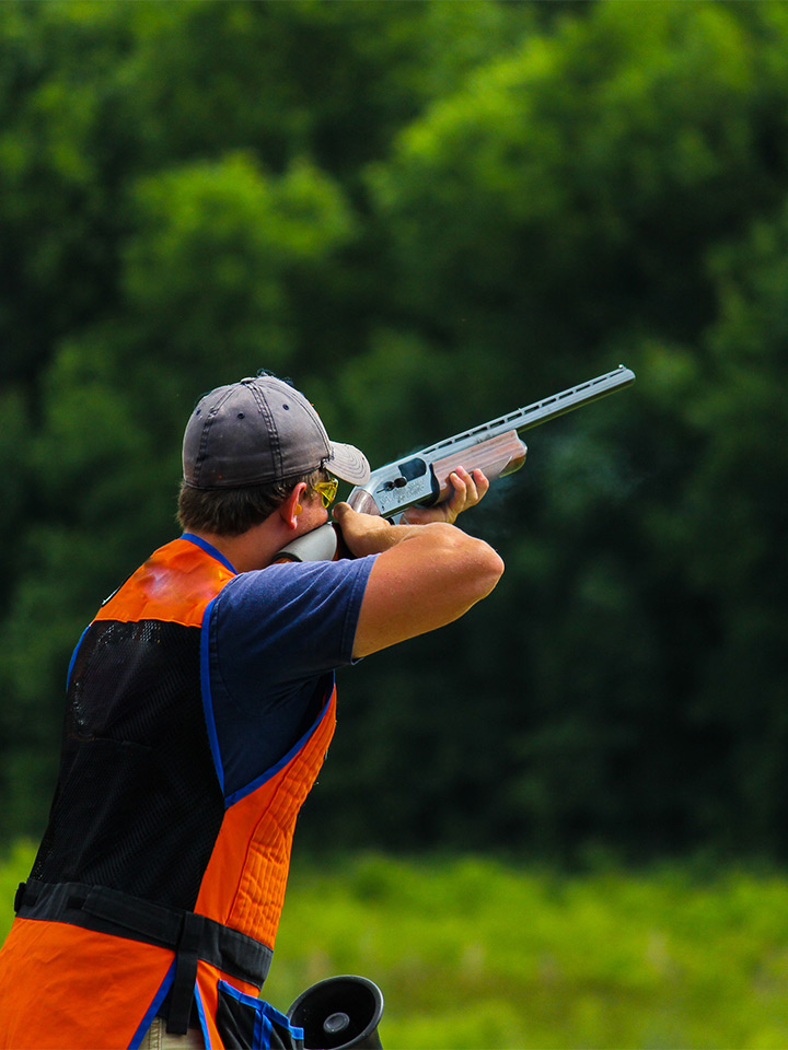 man shooting clays