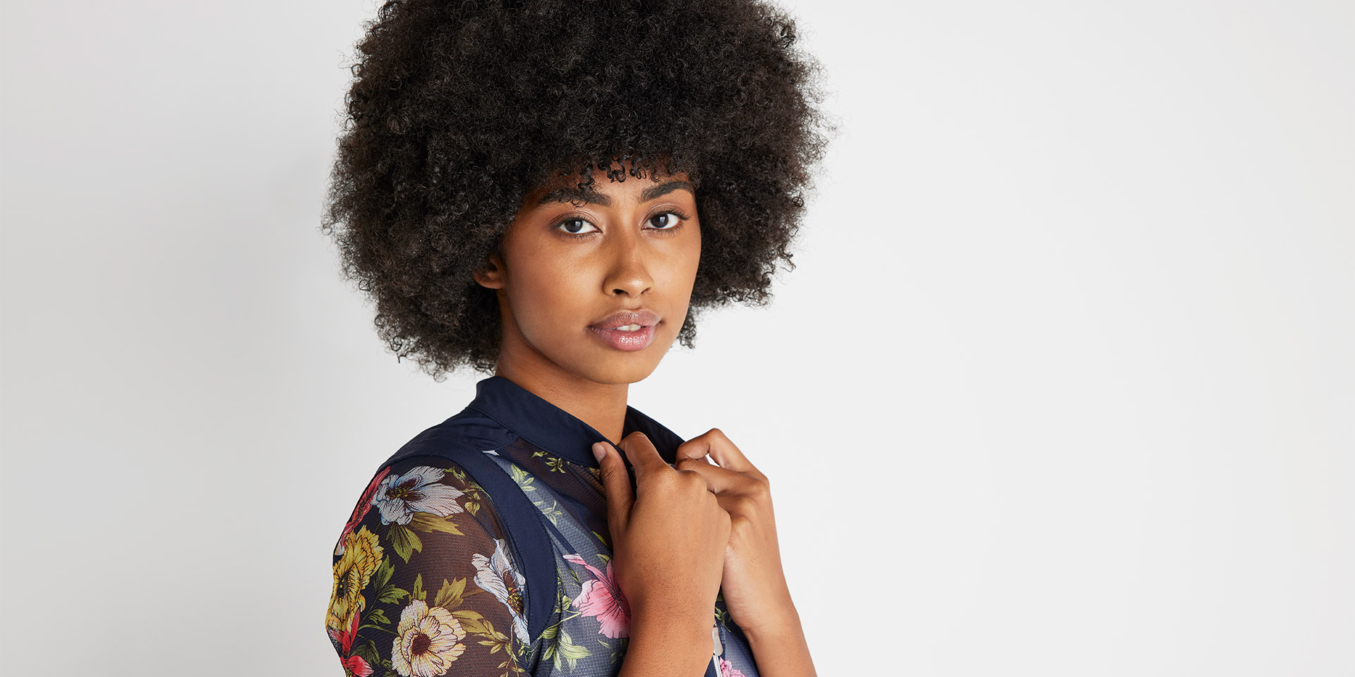 Woman wearing a floral Anatomie top