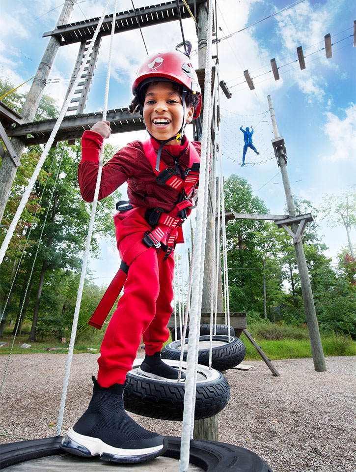 Child exploring ropes course