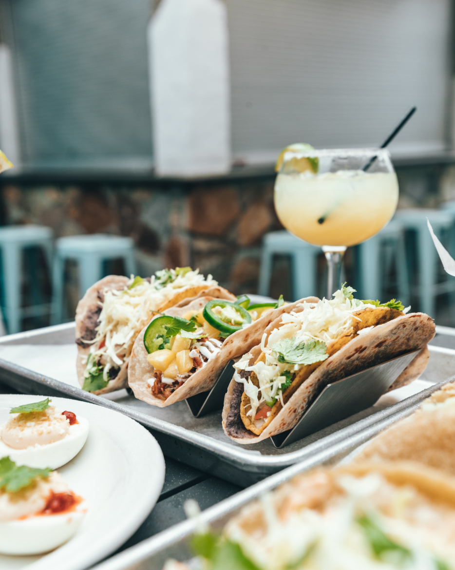 Tacos and a drink outdoors